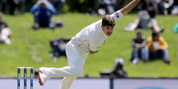 You can't fault Colin de Grandhomme for a solid claim to one of New Zealand's more spectacular entries to test cricket at Hagley Oval today. Photo / Getty Images.