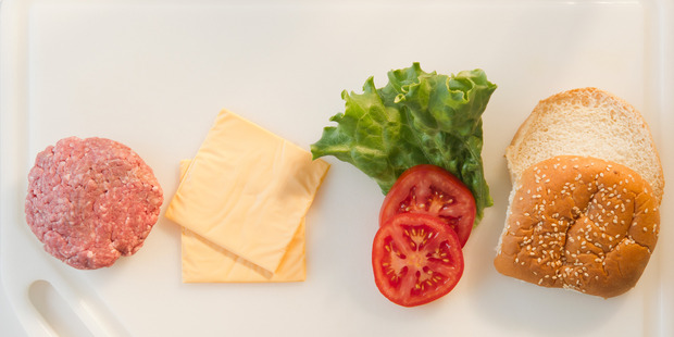 There's nothing wrong with a standard cheeseburger, but some people have taken things to an obscene level. Photo / Getty Images