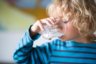 Research suggests that children who drink full-fat milk grow up slimmer than those drinking trim. Photo / Getty Images
