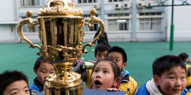 The Webb Ellis Cup visited the Xuhui No 1 Primary School as part of the Rugby World Cup Trophy Tour. Photo / Getty Images