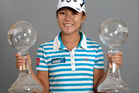 Lydia Ko poses with the CME Race for the Globe trophy following the final round of the CME Group Tour Championship at Tiburon Golf Club in 2015. Photo / Getty Images