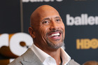 Not only is Dwayne Johnson the highest paid male actor, but he is now the Sexiest Man Alive. Photo / Getty