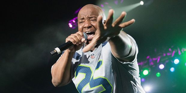TACOMA, WA - AUGUST 26: Young MC performs on stage wearing a Seattle Seahawks Richard Sherman jersey during the I Love The 90s Tour at the Tacoma Dome on August 26, 2016 in Tacoma, Washington. (Phot