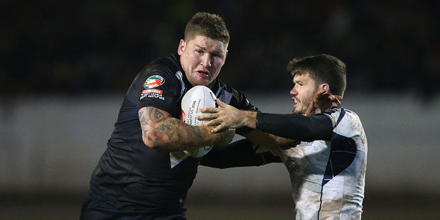 Loading Greg Eastwood of New Zealand is tackled by Lachlan Coote of Scotland. Photo / Getty