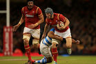 Jonathan Davies of Wales is tackled during the International Match between Wales and Argentina. Photo / Getty