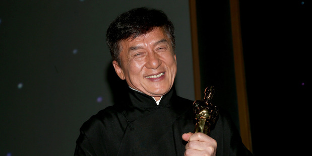 HOLLYWOOD, CA - NOVEMBER 12: Honoree Jackie Chan poses with his award during the Academy of Motion Picture Arts and Sciences' 8th annual Governors Awards at The Ray Dolby Ballroom at Hollywood &