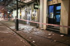 Glass and rubble covers the footpath on Wakefield Street after an earthquake on November 14, 2016 in Wellington. Photo / Getty