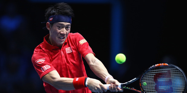 Kei Nishikori hits a backhand during the ATP World Tour Finals. Photo / Getty Images