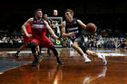 David Stockton of the Breakers drives against Rotnei Clarke of the Hawks. Photo / Getty