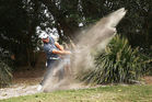 Repair your divot - Ryan Fox seemingly creates a new bunker with a recovery shot from the sand. Photo / Getty