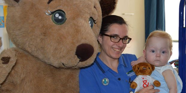 Nurse Sarah McDonald and 10-month-old Luca Jenkins-McHale.