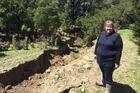 Kara Lynn is stunned at the deep gully that Monday's huge earthquake has created on her property north of Waiau, North Canterbury. Photo / Kurt Bayer