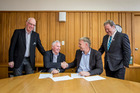 A deed of agreement was signed yesterday by HBRU board chairman Brendan Mahoney (left), CE Mike Bishop, Napier City Council CE Wayne Jack, and Napier Mayor Bill Dalton. PHOTO/SUPPLIED