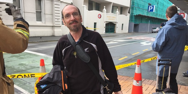 Loading Rob Zorn lives beside the affected building on Tory St, and has had just a couple of minutes to gather up some belongings in a suitcase and evacuate. Photo / NZ Herald