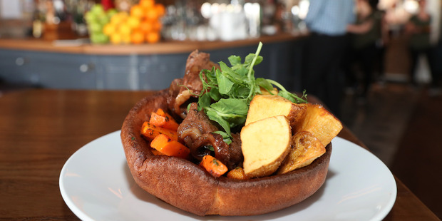 The giant Yorkshire pudding with beef sirloin at Lord Kitchener. Photo / Getty Images