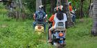 Riding Vespas down long dirt tracks through rural communities.