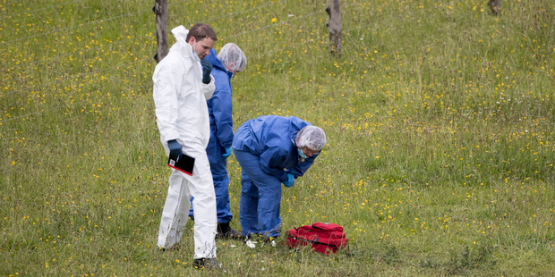 Loading The scene where a woman was found in a paddock with critical injuries near Waiuku. Photo / Dean Purcell