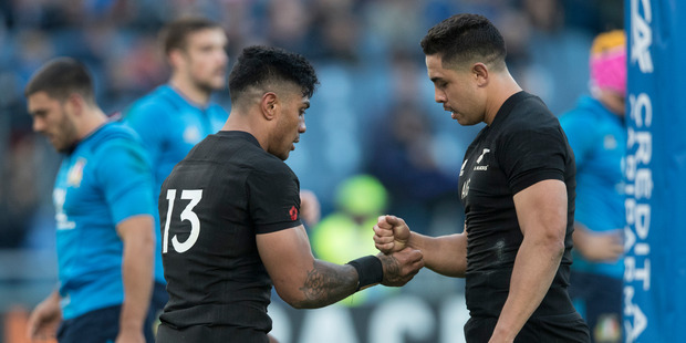All Blacks centres Malakai Fekitoa and Anton Lienert-Brown celebrate a try with a handshake during the test match between the New Zealand All Blacks and Italy. Photo / Brett Phibbs