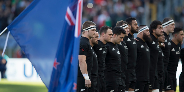 Loading All Blacks during the national anthem during the test match between the New Zealand All Blacks and Italy. Photo / Brett Phibbs
