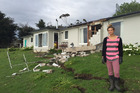 Tess Prentice, 20, outside her family's quake-damaged home at Claverly in North Canterbury. Photo / Kurt Bayer