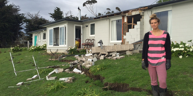 Loading Tess Prentice, 20, outside her family's quake-damaged home at Claverly in North Canterbury. Photo / Kurt Bayer