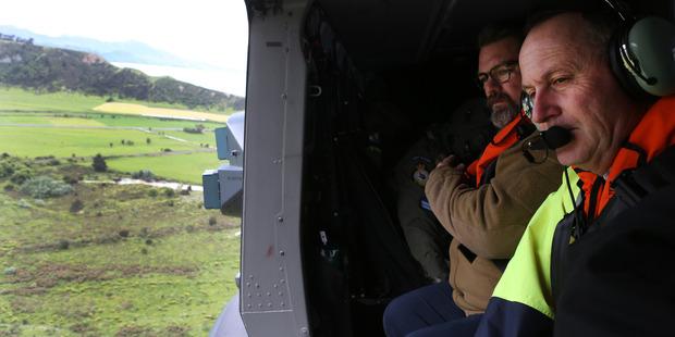 Loading Prime Minister John Key views earthquake damage north of Kaikoura. Photo / Mark Mitchell