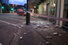 Glass dislodged by this morning's 7.5 earthquake on Wakefield Street in Wellington. Photo / Mark Mitchell