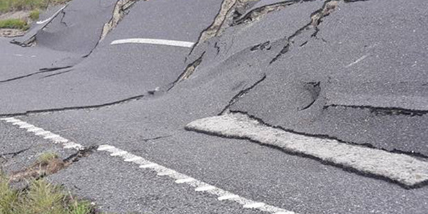 A road is mangled by the 7.5 M earthquake that struck North-Canterbury. The shake set off hundreds of alarms.