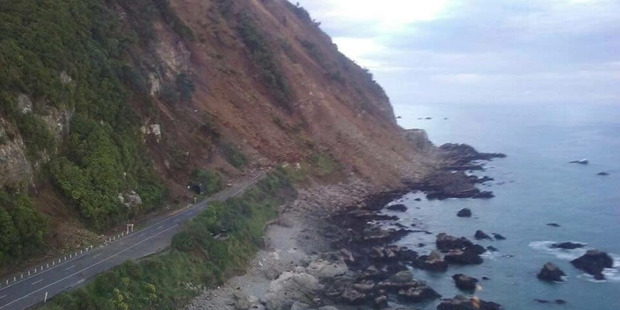 A slip covers State Highway one at Ohau Point between Kaikoura and Marlborough. Photo / Westpac Rescue Helicopter