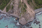 Slips on the coastal road south out of Kaikoura. Photo / NZ Herald
