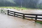 Flooding on Paekakariki Hill Road after heavy rain lashed the Wellington Region. Photo / Angela Bray
