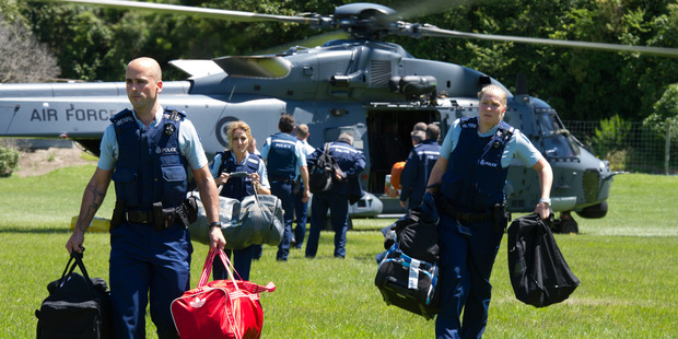 Loading An Air Force NH90 Helicopter arrives in Kaikoura with police and supplies. Four  choppers ferried around 200 tourists out of the town. Photo / NZDF