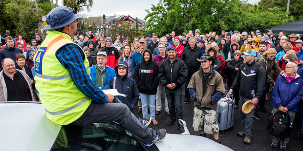 Civil Defence briefs a large crowd of tourists and people wanting to leave Kaikoura. Photo / Mike Scott