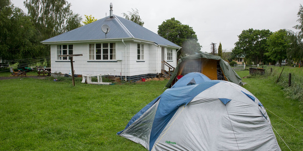 Some Waiau residents have been forced to camp in their backyards. Photo / Mike Scott
