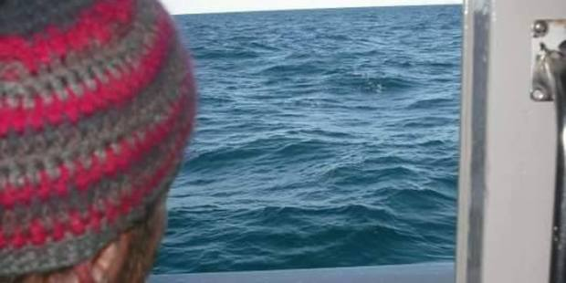 The bottle being thrown off the Olivia Rose while underway between Great Barrier and Waiheke islands on June 9, 2010. Photo / Supplied