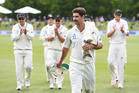 Colin de Grandhomme leads the Black Caps from the field after taking 6/41 on debut. Photo / www.photosport.co.nz