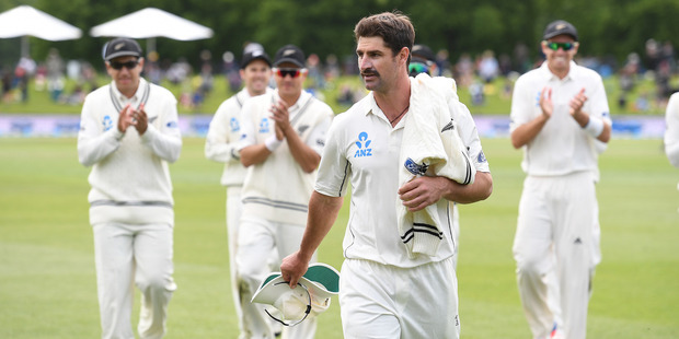 Loading Colin de Grandhomme leads the Black Caps from the field after taking 6/41 on debut. Photo / www.photosport.co.nz