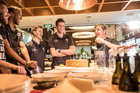 Gusto head chef Sean Connolly teaches the Breakers, including David Stockton (third from left), how to make Carbonara. Photo / Michael Craig - NZ Herald.
