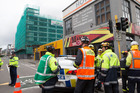 Police and Fire Service staff securing the area around the Reading Cinema Car Park building. Photo / Mark Mitchell