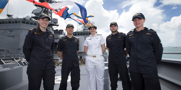 Loading New Zealand Navy staff l-r, LT. Sophie Going, SLT. Kyu Han Kyeong, SLT. Laura Stapley, SLT. Wilem Pieterse and LT. Anna Hill on board HMNZS Te Mana, while being docked in Wynyard Quarter, Auckland, fo