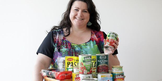 Hayley McIsaac, Edvance instructional designer, is running a can drive with all the businesses she works with throughout the city. Photo/Andrew Warner