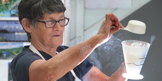 Loading BAKING: Tauranga Community Foodbank volunteer Anne Brown packages ready-made baking bags. Photo/John Borren