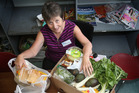 Tauranga Community Foodbank volunteer Gill Hosie with what goes into a food parcel. Photo/John Borren .