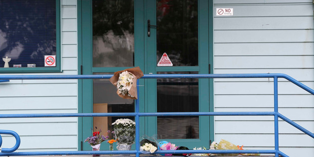 Floral tributes outside the Angels Childcare centre in Takapuna after a four year old boy died yesterday. Photo / Chris Loufte