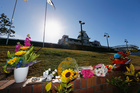 A sea of floral tributes sprang up at Dreamworld's entrance following the tragedy. Photo / Getty Images