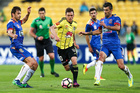 Michael McGlinchey of the Phoenix attempts to beat the Jets defence during the round five A-League match. Photo / Getty Images.