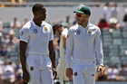 South Africa's captain Faf du Plessis, right, chats with bowler Kagiso Rabada. Photo / AP.