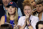Upset supporters watch the election results during Hillary Clinton's election night rally. Photo / AP