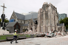A relief worker walks past the earthquake-damaged Christchurch Cathedral in Christchurch. Photo / AP
