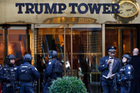 Members of the New York Police Department's counterterrorism unit guard Trump Tower. Photo / AP